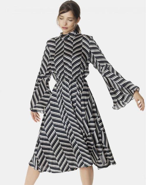 74fbf9c4a06c Το midi ασπρόμαυρο ριγέ φόρεμα Regalinas έχει όλα τα χαρακτηριστικά για να  σας μετατρέψει σε μία business woman ή μία θελκτική ύπαρξη για ένα ραντεβού  με το ...