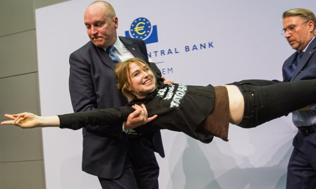 A protester interrupts a news conference at the European Central Bank